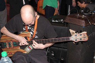 Devin Bohart with the Hilton sk8bass at the GHS Booth